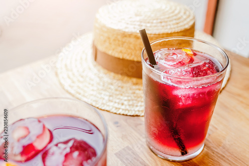Tuinposter Cocktail Sangria spanish fruit drink on a table with hat