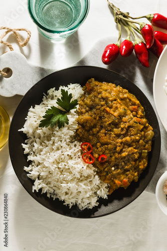 Vászonkép  Basmati rice with curry from vegetables and lentils