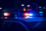 Closeup of Police Lights on Dark Street at Night