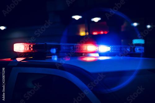 Closeup of Police Lights on Dark Street at Night Fotobehang