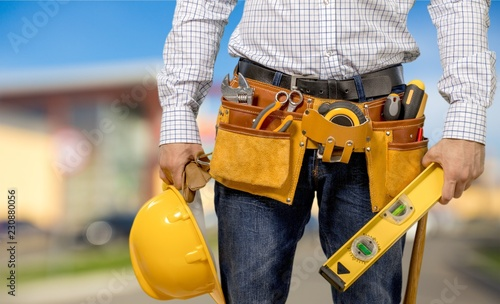 Fototapety, obrazy: Male worker with tool belt isolated on white  background