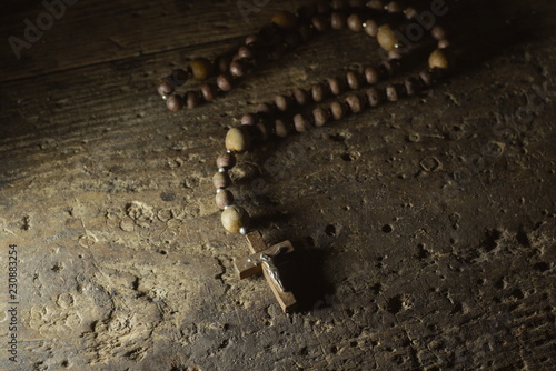 Fototapeta A wooden rosary on an old wooden background
