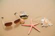 background sunglasses starfish on the beach sand