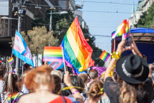 Fotografía  Crowd raising and holding rainbow gay flags during a Gay Pride