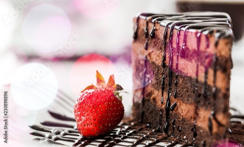 Piece of cake with chocolate creame and