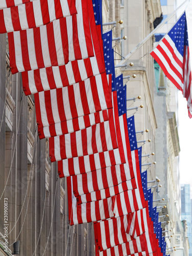 Photo  Set of american flags of united states of america outside building