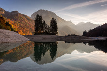 Beautiful Reflection At Lake Predil, Italy With Colorful Trees In Background In Autumn Season