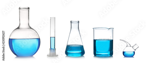 Set with different laboratory glassware and liquid for analysis on white backgro Wallpaper Mural