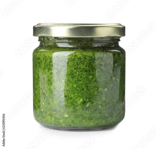 Fotografia Homemade basil pesto sauce in glass jar on white background