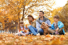 Happy Family With Children And Dog In Park. Autumn Walk