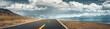 Leinwanddruck Bild - Road to mountain along lake