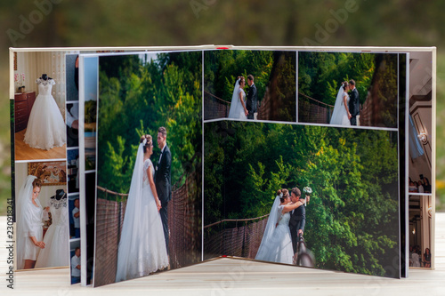 Vászonkép Open pages of brown luxury leather wedding book or album