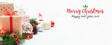 Christmas And New Year Holidays Gift Box With Decorative Ornament On Table With Falling Snow Effect Banner.Merry Christmas & Happy New Year 2019.Gifts And Congratulations Concept.