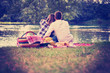 canvas print picture Couple taking a selfie by mobile phone while enjoying picnic time
