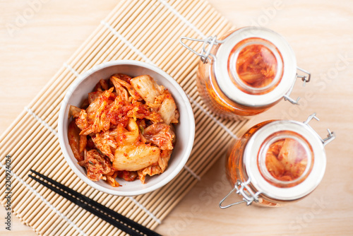 Kimchi cabbage in a bowl and jar with chopsticks for eating, Korean food