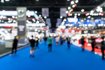 Blur, defocused background of public exhibition hall. Business tradeshow, job fair, or stock market. Organization or company event, commercial trading, or shopping mall marketing advertisement concept