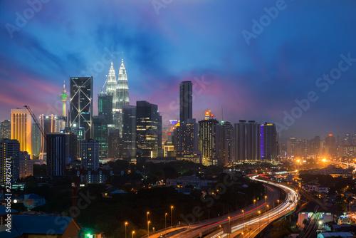 Tuinposter Stad gebouw Kuala Lumpur skyline and skyscraper at night in Kuala Lumpur, Malaysia.