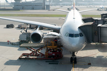 Loading Cargo On Plane In Airp...