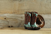 Cowboy Boots And Hat Isolated On A Natural Wood Background With Writing Space
