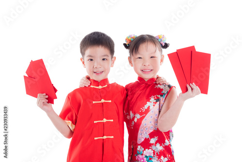ff78b6256 Two chinese children in traditional costume holding red packet money and  smile over white background