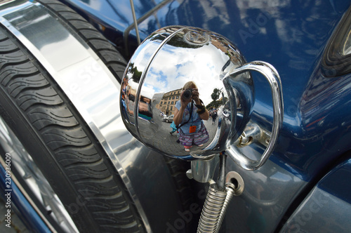 Funny the reflection of a woman photographer in the chrome