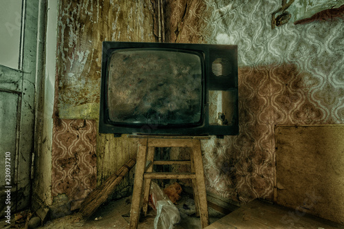 Creepy broken television in dirty room of abandoned house Wallpaper Mural