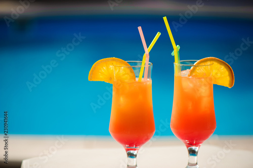 Cocktails on the background of the pool Fototapeta