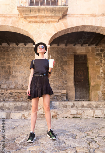 Foto  Tourism in Europe, woman tourist on the street near old building