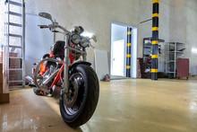 Orange Motorcycle In Service Center.