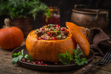 Whole Pumpkin Stuffed With Barley And Vegetables, Served With Pomegranate And Parsley