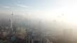 4k cinematic b-roll drone establishing shot of Kuala Lumpur city skyline during low cloud sunrise