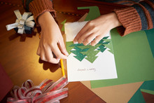 Hands Of Woman Making Greeting Card For Christmas