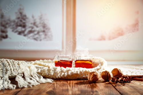 Mulled wine on a wooden table in a winter scenery