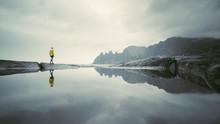 Adventurous Man Standing On S...