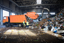 Two Workers Of Recycling Plant...
