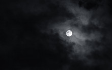 Full Moon With Dark Clouds In ...