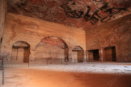 Fototapeta Interior chamber of Urn Tomb of Royal Tombs, ancient Rose City of Petra, Jordan