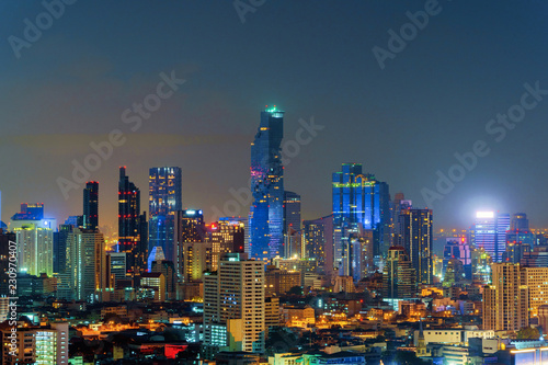 Aerial view of Sathorn, Bangkok Downtown. Financial district and business centers in smart urban city in Asia. Skyscraper and high-rise buildings at night. Thailand