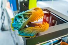 3D Printer Printing Dragon Head Figure Close-up.