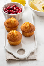 Muffins, Cakes With Cranberry And Lemon On A White Board.