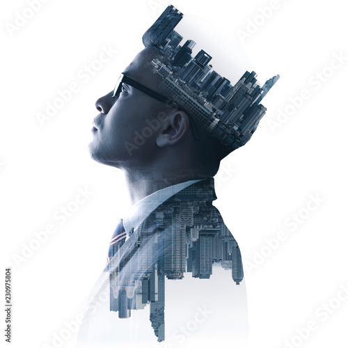 The double exposure image of the businessman thinking overlay with cityscape image. The concept of modern life, business, city life and internet of things.