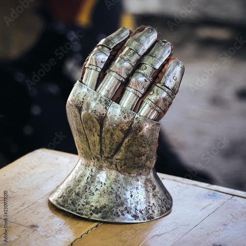 A closeup of an antique steel glove