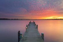 A Lake At Sunset With Beautifu...