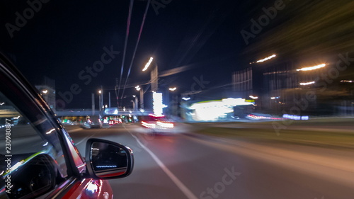 Obraz na płótnie Drivelapse from side of car moving on a night avenue in city timelapse hyperlaps