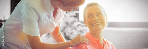 Female nurse consoling senior woman Canvas Print
