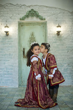 A Handsome Little Boy And A Sweet Girl In Medieval Historical Costumes