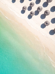 Fototapeta Aerial view of amazing tropical white sandy beach with palm leaves umbrellas and turquoise sea, Mauritius.