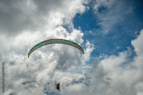 Photo sur Toile Aerien Paraglider is flying in the clouds