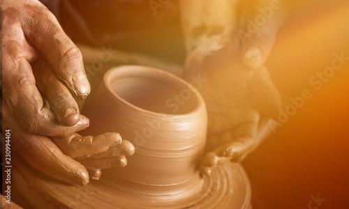 Fotomural  Hands of potter making clay pot, closeup photo