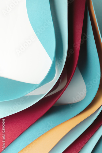 Curved elements on white background, colorful wavy stripes